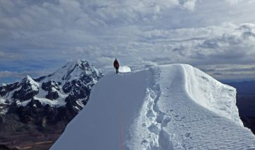 Traversing the summit crest of Nevado Caracol