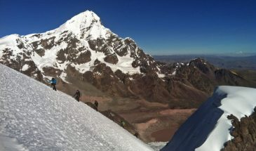 A rope team arrives to the summit of Campa peak