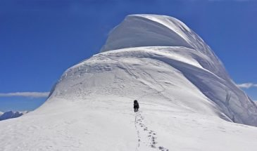 A climber heading towards the summit of Chopicalqui