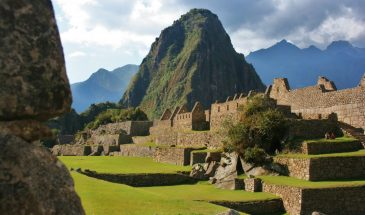 Majestic Huayna Picchu peak rises out of Machu Picchu buildings